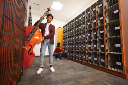 AcoustiCabinets® line the walls for efficient instrument storage.